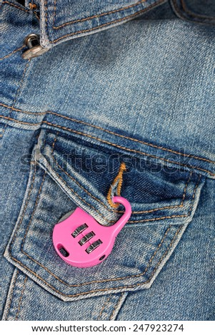 Concepts of protection against unwanted feelings - lock on breast pocket - stock photo