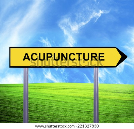 Conceptual arrow sign against beautiful landscape with text - ACUPUNCTURE - stock photo