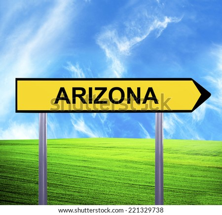 Conceptual arrow sign against beautiful landscape with text - ARIZONA - stock photo