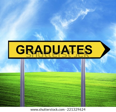 Conceptual arrow sign against beautiful landscape with text - GRADUATES - stock photo