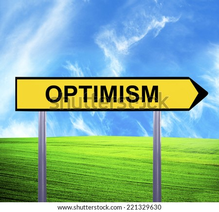 Conceptual arrow sign against beautiful landscape with text - OPTIMISM - stock photo
