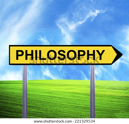 Conceptual arrow sign against beautiful landscape with text - PHILOSOPHY - stock photo
