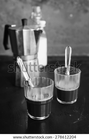 Conceptual black white image with two cups of coffee.