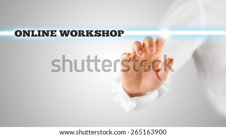 Conceptual Businessman Ticking a Glowing Light with Online Workshop Label on an Abstract Grey Background. - stock photo