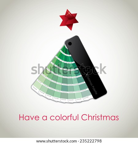 Conceptual Christmas Card: a Christmas tree made by a green colors palette, with a red origami star on the top, with a Christmas wish on the bottom - stock photo