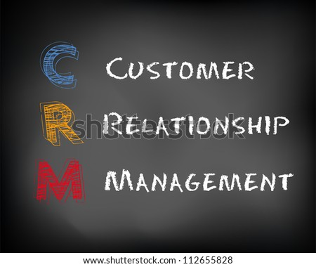 Conceptual CRM acronym concept on black chalkboard. Customer Relationship Management slide concept. - stock photo