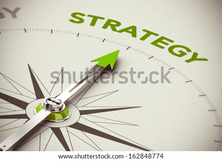Conceptual 3D render image with depth of field blur effect. Compass needle pointing the green word strategy over natural paper background.  - stock photo