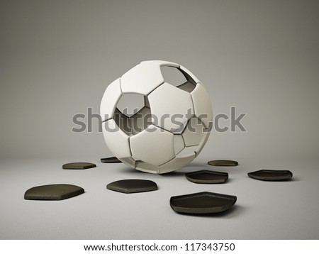 conceptual  football ball isolated on a grey - stock photo
