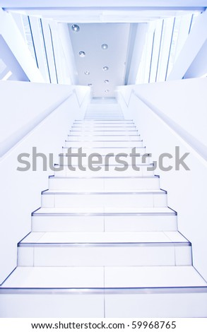 Conceptual futuristic stairs in white hall