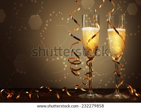 Conceptual Golden Brown Wine on Elegant Glass with Spiral Thin Wrapping Foils or Laces Decoration, on Abstract Brown Background. - stock photo