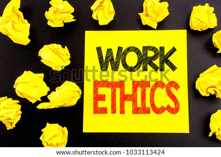 Conceptual hand writing text showing Work Ethics. Business concept for Moral Benefit Principles written on sticky note paper. Folded yellow papers on the background