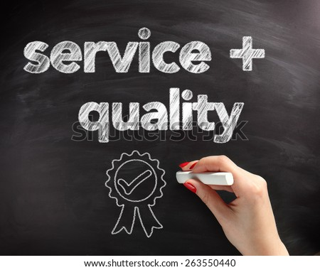 Conceptual Handwritten Service and Quality Texts on Black Chalkboard with Ribbon Drawing Design. - stock photo