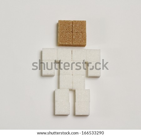 Conceptual human body made by sugar cubes - stock photo
