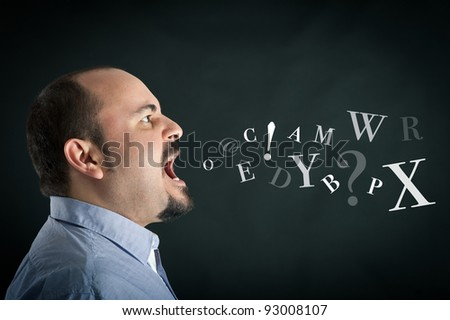 Conceptual image. Angry man shouting against black background with letters coming out from his mouth. - stock photo