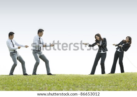 Conceptual image, Asian Business man and woman playing tug of war