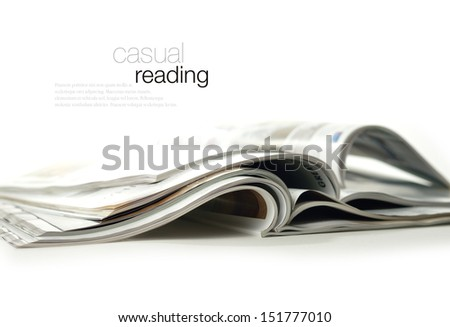 Conceptual image for marketing communications and advertising. High key studio image of glossy magazines against a white background with soft shadows. Copy space. - stock photo