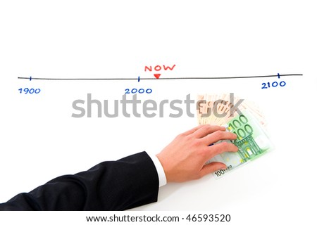 Conceptual image illustrating someone putting money aside for the future. Time is represented by a numbered line - stock photo