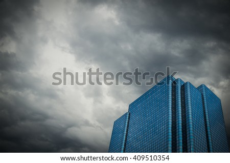 Conceptual Image Of A Financial Building Set Against A Stormy Sky Representing An Economic Crisis - stock photo