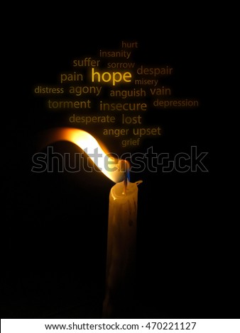 Conceptual image of a hope illustrated with a candle light blown in the wind and wording on the background