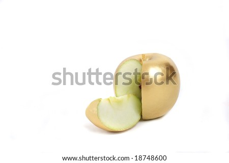 Conceptual image of a sliced golden apple - stock photo