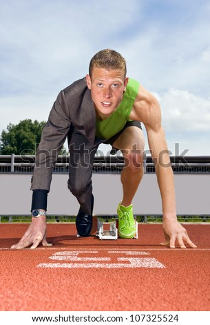 Conceptual image of an athlete (sprinter) ready to start a business career. Performance in business is top sport - stock photo