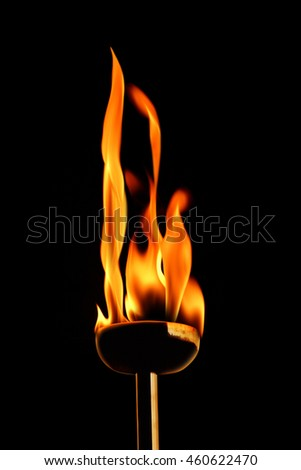 conceptual image of burning flaming torch