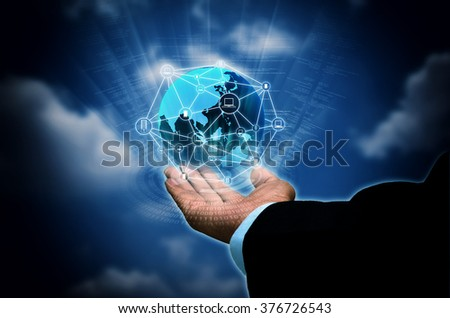 Conceptual image of businessman holding internet connectionglobe  between computers, server, laptop and smart phone