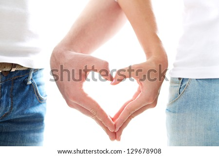 Conceptual image of female and male hands making up heart shape - stock photo