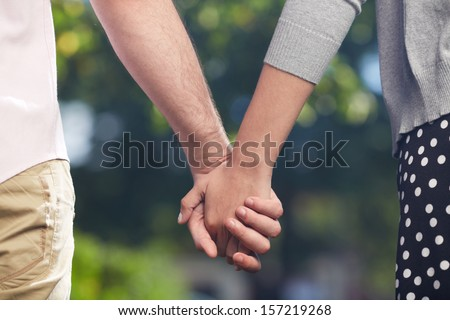 Conceptual image of female and male hands together  - stock photo