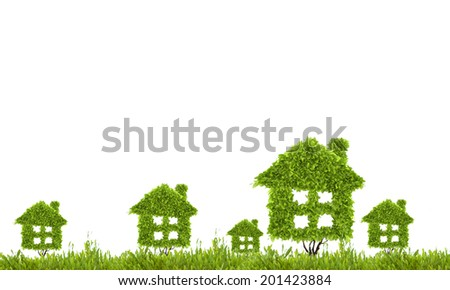 Conceptual image of green plant shaped like house - stock photo