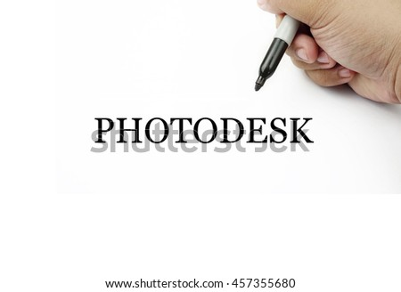 Conceptual image of handwriting PHOTODESK with the hand and pen isolated in white background.
