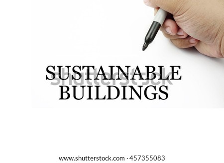 Conceptual image of handwriting SUSTAINABLE BUILDINGS with the hand and pen isolated in white background.