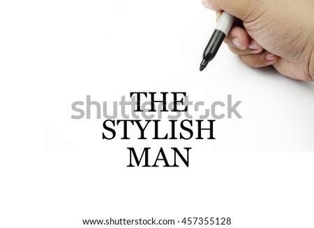 Conceptual image of handwriting THE STYLISH MAN with the hand and pen isolated in white background.