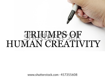 Conceptual image of handwriting TRIUMPS OF HUMAN CREATIVITY with the hand and pen isolated in white background.