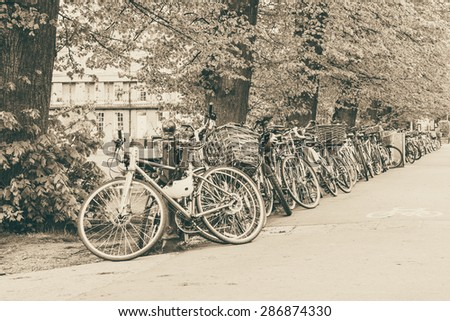 Conceptual image of student life in Cambdrige, bikes locked next to Parker's piece, England closeup