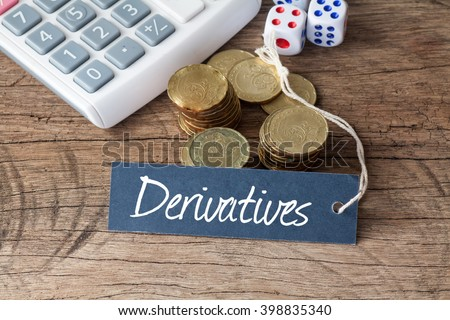 Conceptual image of the word Derivatives written on label tag with coins,dice and calculator - stock photo