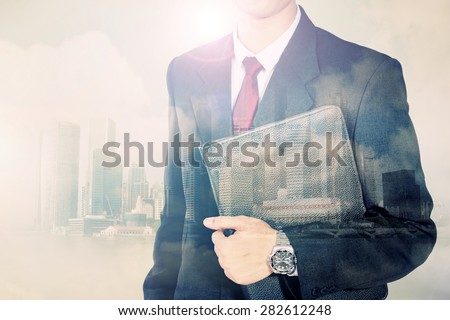 Conceptual image of urban lifestyle. Double exposure of business man body in suit and modern city horizon - stock photo