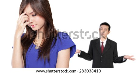 Conceptual image of young Asian business couple in a fight situation, isolated on white background
