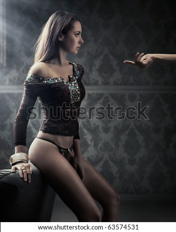 Conceptual image of young beauty following man's hand - stock photo