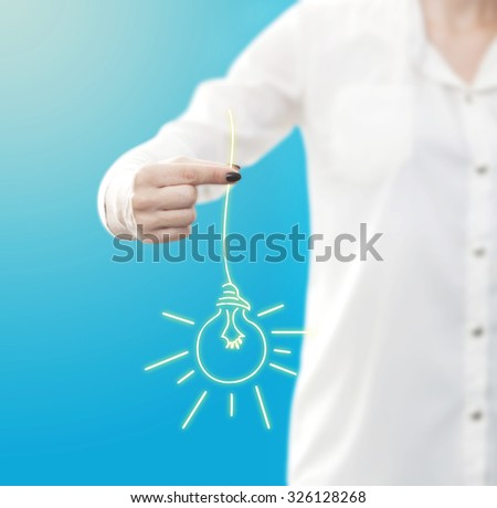 conceptual image , showing a woman holding or giving a light bulb - stock photo