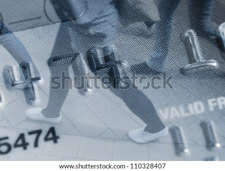 Conceptual image showing shoppers walking over credit card