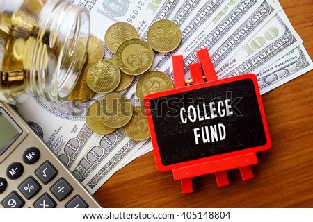 Conceptual image with COLLEGE FUND words. Hundred dollar bills, coins and calculator on wooden background. - stock photo