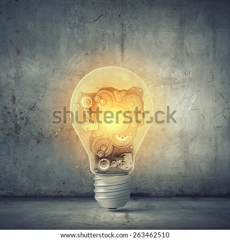 Conceptual image with light bulb and gears inside - stock photo