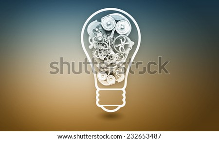 Conceptual image with light bulb filled with gears