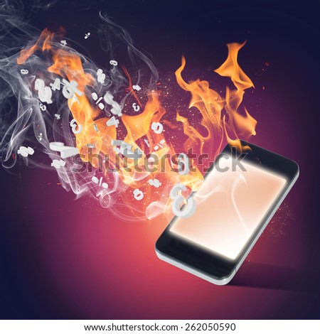 Conceptual image with mobile phone burning in flames - stock photo