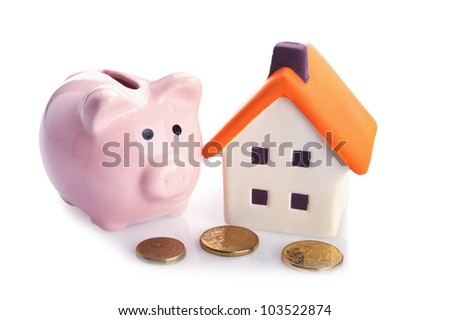 conceptual image with piggy  bank, coin and house - stock photo