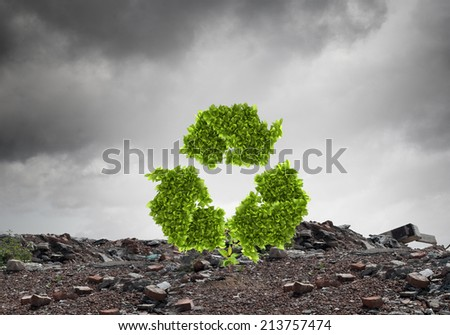 Conceptual image with recycle green sign growing on ruins - stock photo