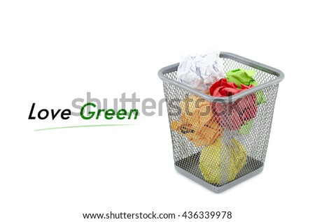 """conceptual image with word """"LOVE GREEN """" over crumple paper in metal dustbin and isolated white background - stock photo"""