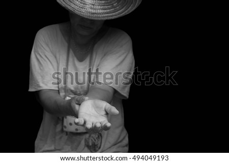 Conceptual immigrant crisis Refugee raising her hand need  help in black and white