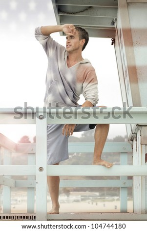 Conceptual outdoor portrait of a young blond all-American man with USA stars and stripes effect - stock photo